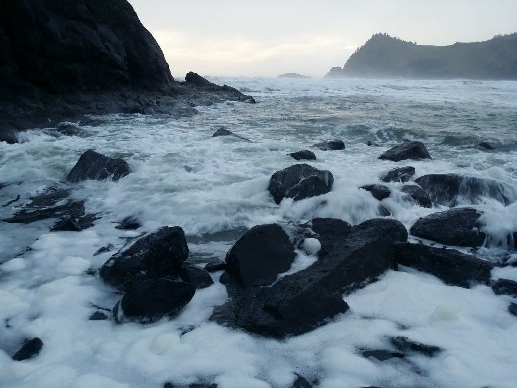 Sea Foam amidst newly exposed rocks near Needle's Eye