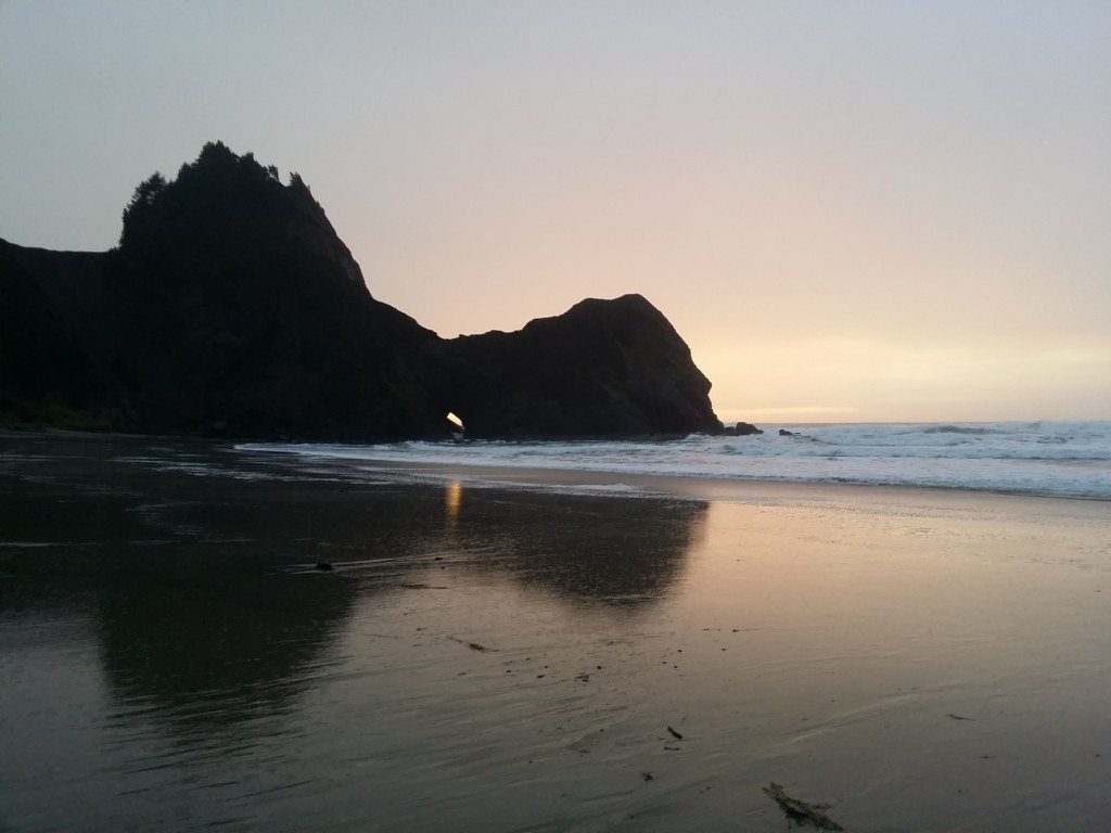 Sunset through Needle's Eye after high tide and winter storms