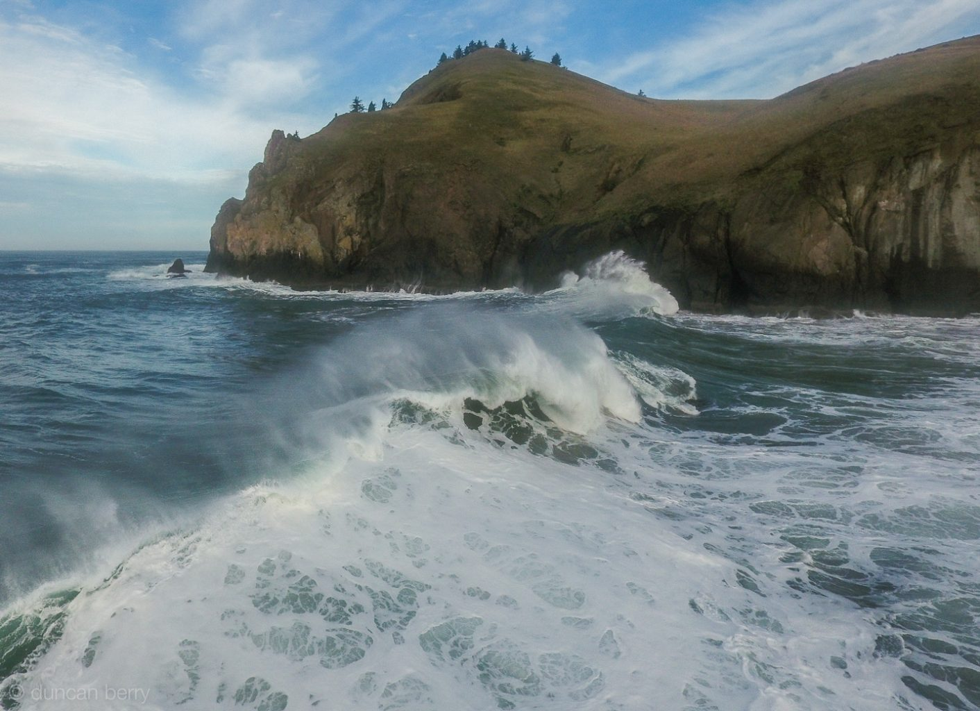Big waves rolling into Salmon River mouth below Cascade Head