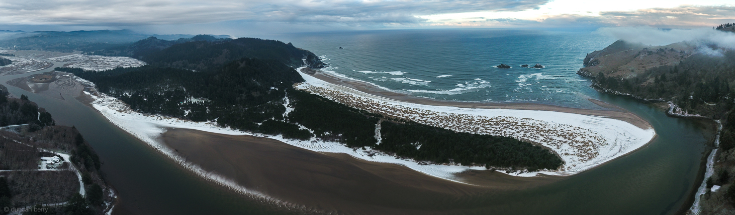 Fish-eye aerial of Westwind and mouth of Salmon River in winter
